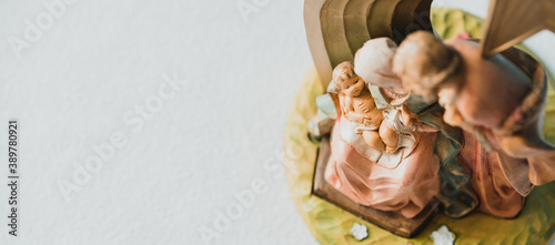 Christmas nativity scene of born child baby Jesus Christ in the manger with Joseph and Mary Fototapet