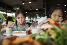 Two Asian Child Girls Eating D...