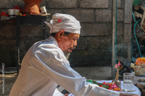 Closeup photograph of a Balinese Hindu high priest conducting a Ngaben ceremony Canvas Print