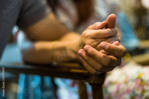 Fototapeta Closeup on two young lovers holding hands at a table, symbol sign sincere feelings, compassion, loved one, say sorry