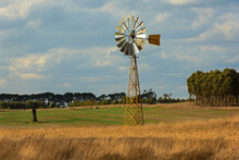 Sunlit Windmill In A Paddock In Country Victoria, Australia.