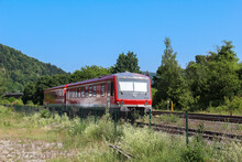 View Of A Red Regional Train Of Two Cars In Germany On A Blue Sky Background