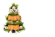 The Concept Of Sushi On Christmas. Sushi On A White Plate In The Form Of A Christmas Tree On A White Background.Creative Idea For A Japanese Restaurant. Flatly.The View From The Top. Copyspace.