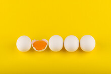 Chicken Eggs On Yellow Backgro...