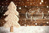 Fototapeta Kawa jest smaczna - English Calligraphy Save The Date. White Fabric Christmas Tree With Snow. Brown Rustic Wooden Background With Snowflakes