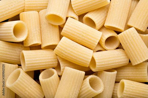 Tela Artisan italian durum wheat pasta, raw mezzi rigatoni, top view.