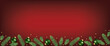 Red Christmas Table with green fir and balls baubles ornaments. Top view, flat lay. Xmas greeting Card banner web header. Spruce tree border.