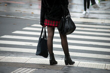 Closeup Of Youg Woman Standing In The Street With A Mini Skirt