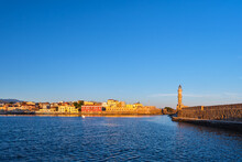 Iconic View Of Old Venetian Harbour , Chania, Crete, Greece In Morning. Famous Old Port Lighthouse, Maritime Museum, Firka Fortress. Golden Hour Shot