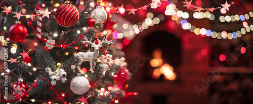 Christmas Tree with Decorations Near a Fireplace