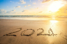 2021 Written On The Beach At Sunset. Sign On The Sand. New Year Seascape.