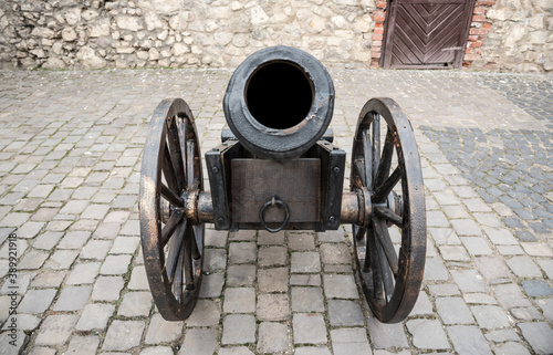 Old cannon. Antique iron cannon on wheels. Canvas Print