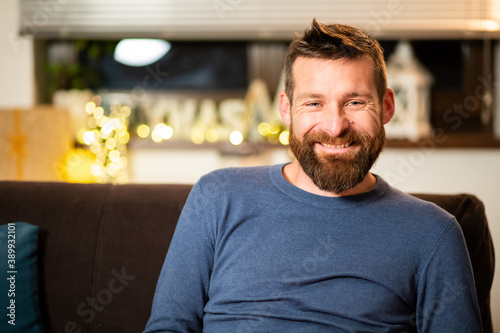 man with cat celebrating Christmas at home social distancing