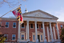 Low Angle View Of Maryland State Flag In Front Of The Capitol State House In Annapolis, MD.