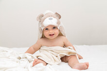 Beautiful And Adorable Baby Smiling Just Out Of Bathing. He Is Wrapped With A Towel With Bear Hood.