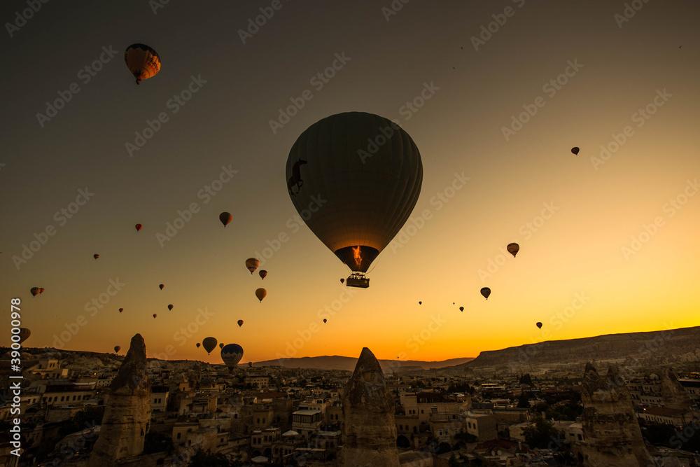 Fototapeta Stunning shot of hot air balloons flying over the Cappadocia region in Turkey