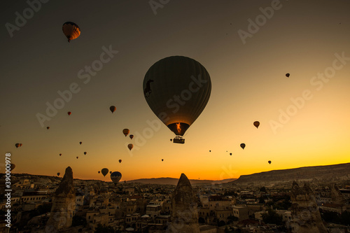 Stunning shot of hot air balloons flying over the Cappadocia region in Turkey Canvas Print