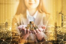 Business Woman Holding Gold Bar Stack In Her Hand