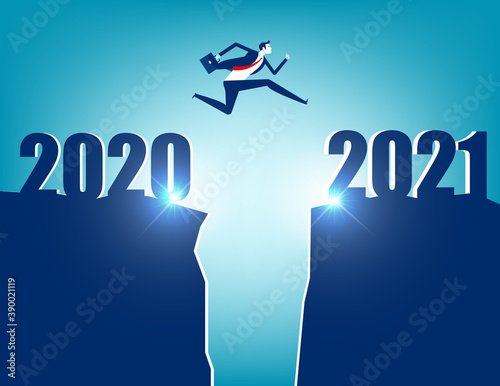 A business person jumping to new year 2021 Wall mural