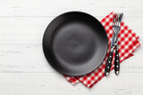 Fototapeta Kawa jest smaczna - Black empty plate, fork, knife and napkin