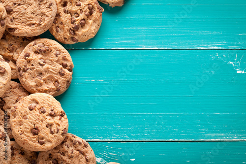 Fototapeta Chocolate cookies on turquoise wooden table obraz
