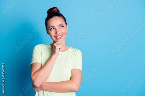 Photo of minded girl touch fingers chin look empty space think isolated over blue pastel color background