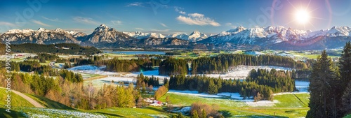 Canvas Print panoramic landscape in Bavaria with alps mountains and meadow at springtime