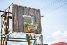 Old Basketball Ring On An Old Wooden Shield With Shabby Paint Over Clear Blue Sky, Outdoor Day Light, Sport Concept
