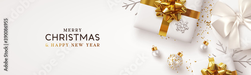 Obraz Christmas banner. Background Xmas design of realistic white gift box, silver 3d render snowflake and glitter gold confetti, bauble ball. Horizontal christmas poster, greeting card, headers for website - fototapety do salonu