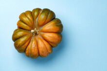 Top View Of Striped Pumpkin On Blue Pastel Background
