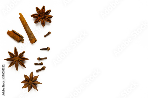 Fototapeta Close-up of cloves, anise and cinnamon on white background. Top view, flat lay, copy space, isolated obraz