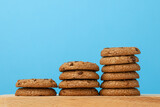 Fototapeta Kawa jest smaczna - Stack of chocolate chip cookies against blue background