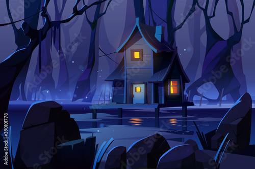 Tablou Canvas Wooden mystic stilt house on swamp in night forest