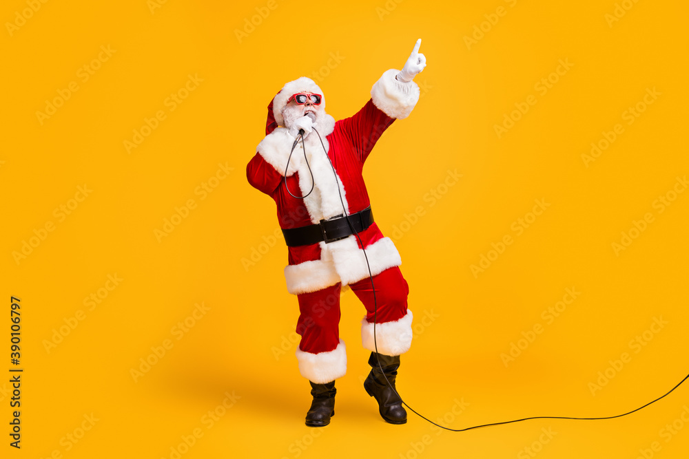 Fototapeta Full length photo of crazy overweight santa claus sing microphone christmas x-mas song on noel party wear headwear cap sunglass isolated over bright shine color background