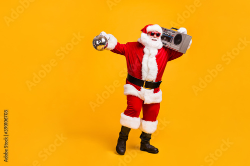 Obraz na plátně Full length photo of funky santa claus with grey beard hold boom box disco ball