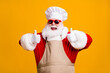 canvas print picture Crazy santa claus with beard in chef headwear cook show thumb up sign x-mas christmas holly jolly feast cooking wear apron sunglass isolated bright shine color background
