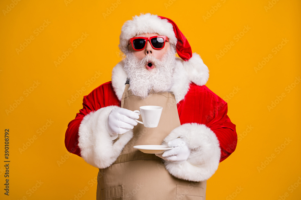 Fototapeta Close-up portrait of his he nice attractive amazed wondered astonished Santa shop owner businessman drinking cappuccino cafe cafeteria taste isolated bright vivid shine vibrant yellow color background