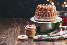Homemade Christmas Bundt Cake And Linzer Cookies On A Wooden Table