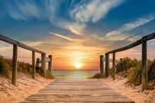 Beachside Pathway Leading To The Ocean With Spectacular Sunrise