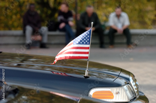 Photo Closeup of American flag attached to car