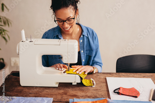 Fotografia, Obraz Woman sewing protective face masks at home