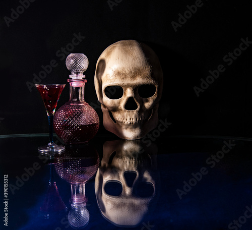 Photo skull and skeletons of people and animals on a black background as an attribute