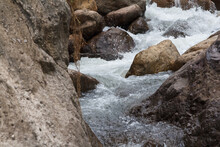 Close Up Of A Little Cascade Falls Of Water Over Mountain River Rocks.