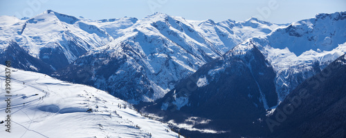 Panoramic view of the winter snowy mountains near Whistler ski resort in Canada. #390163768