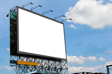Blank Canvas Billboard White Screen Design For Display Advertising Banner Outdoor. Large Mockup Ad Banner With Blue Sky And Cloud.