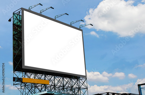 Fototapeta blank canvas billboard white screen design for display advertising banner outdoor. large mockup ad banner with blue sky and cloud. obraz
