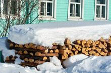 Wood Piled In A Woodpile Under...