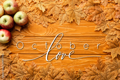 top view of ripe apples and autumnal foliage near october love lettering on wood Fotobehang