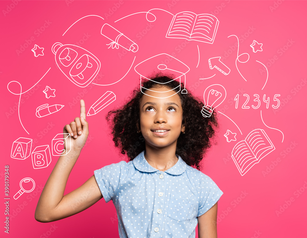 Fototapeta curly african american kid pointing with finger and looking up near illustration on pink