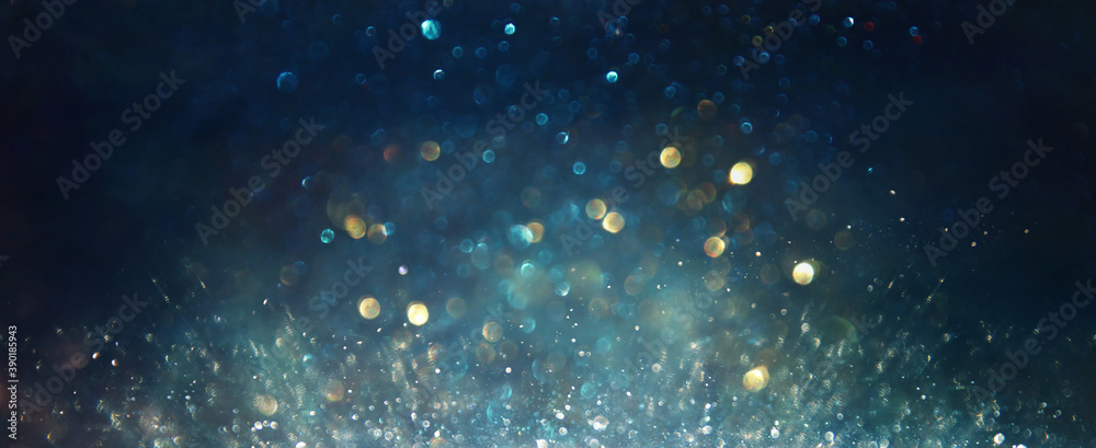 Fototapeta background of abstract glitter lights. silver, blue and black. de focused
